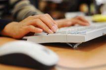 woman's hand on computer